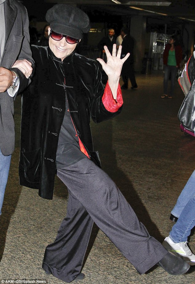 Show us your jazz hands! Liza Minnelli, 66, proves life is still a cabaret as she high kicks around the airport