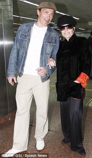 Keeping her company: Liza was seen with two different men on her arm as she strolled through Guarulhos International Airport