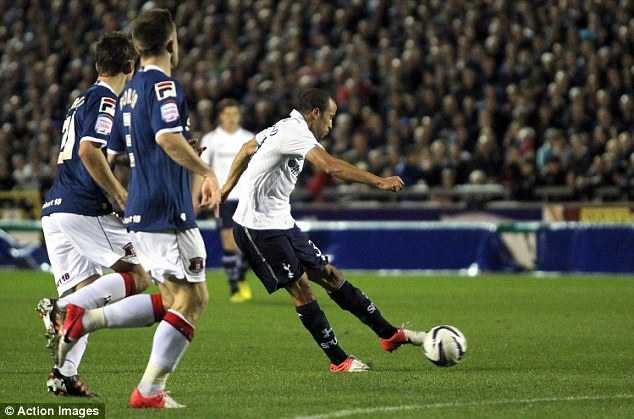 Secured: Andros Townsend fires home Tottenham's second goal