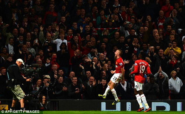 Relief: Tom Cleverley was delighted to score after missing a sitter earlier in the game