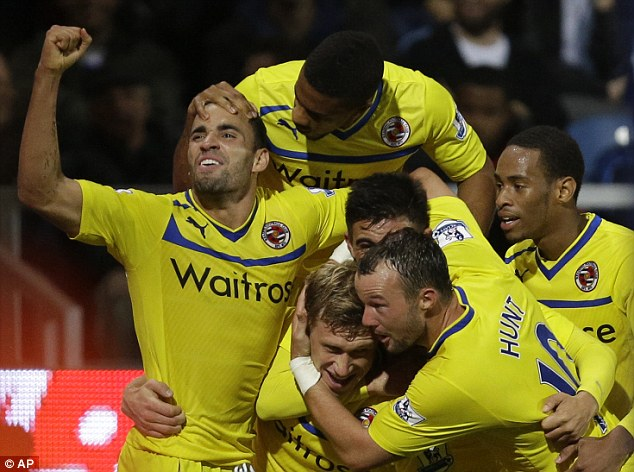 Job done: Pavel Pogrebnyak grabbed the winner for Reading as they progressed to the fourth round