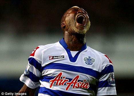 Djibril Cisse celebrates his goal for QPR against Reading in the League Cup tie