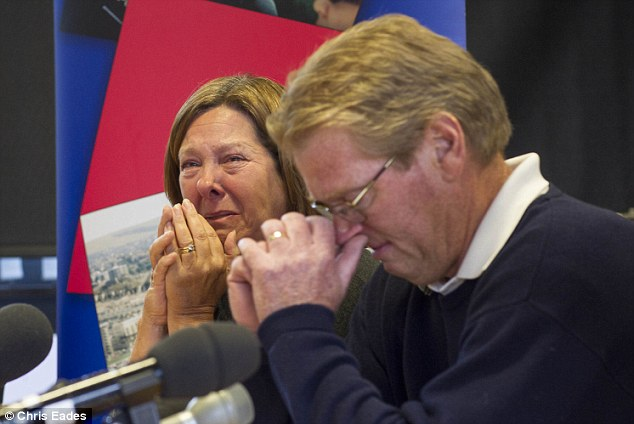 Tearful plea: Jeremy Forrest's parents Julie and Jim begged their son to return home at a press conference yesterday