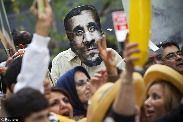 Day of protest: A mask depicting Iranian president Mahmoud Ahmadinejad is seen during a protest against his presence at the U.N. General Assembly