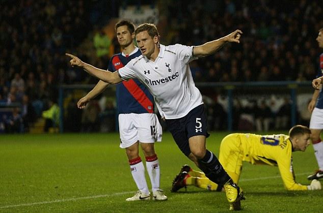 On their way: Jan Vertonghen celebrates scoring Tottenham's first goal