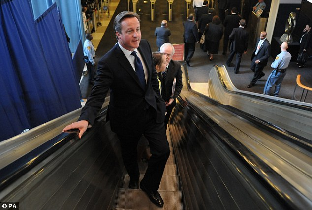 Straphanger: Mr Cameron braved the New York City subway on his way to addresses the UN General