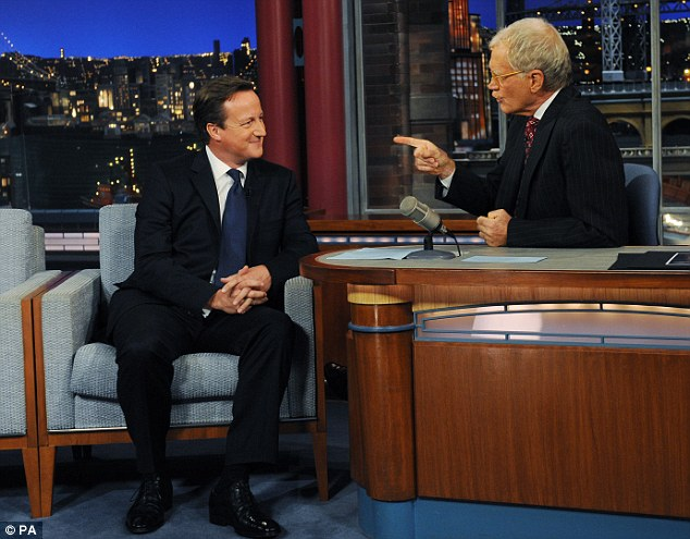 Making a point: After an apparently warm welcome, David Cameron is grilled by U.S chat show king David Letterman on British history, which left him squirming in his seat