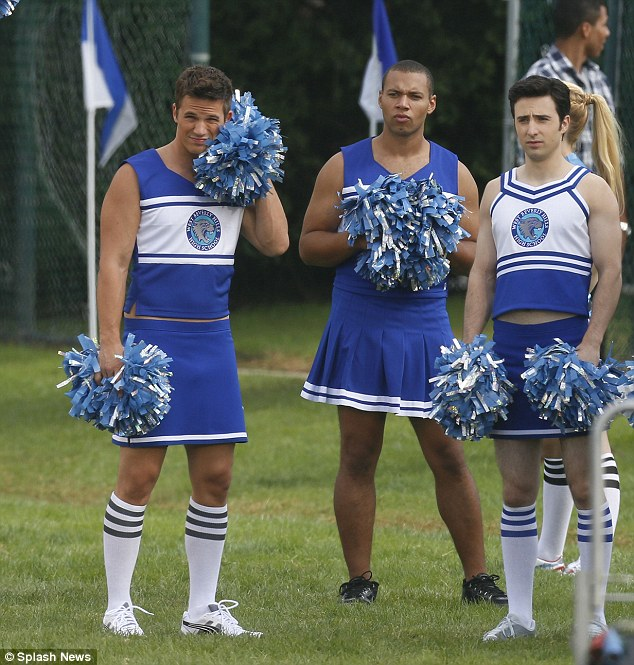 Suits you, sir: Matt Lanter and some fellow male co-stars slipped into cheerleader outfits as they watched the girls play