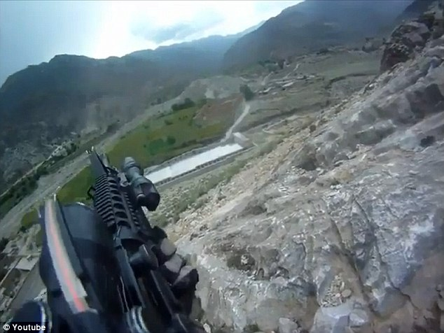 Courage under fire: The soldier's helmet cam is running as he and his unit come under heavy fire in Afghanistan