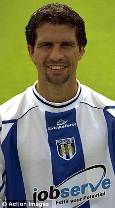 Local hero: New Colchester United manager Joe Dunne during his playing days