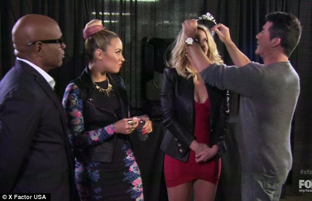 Backstage: After making Simon wear the tiara, it was then put on Briney while Demi Lovato and LA Reid looked on