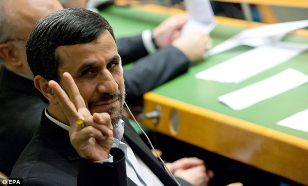 Controversial: Iranian president Mahmoud Ahmadinejad gives a 'V' peace sign before addressing the United Nations General Assembly at UN headquarters in New York City, New York