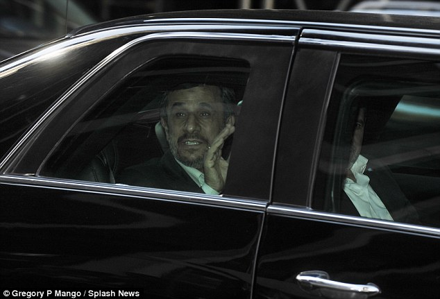 Making an exit: Iranian President Mahmoud Ahmadinejad waves from the back of his chauffeur driven car as he leaves the Warwick Hotel