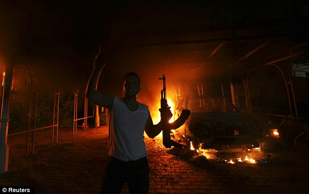 Flames: The White House has admitted they knew the deadly assault, pictured, was an act of terrorism within 24 hours