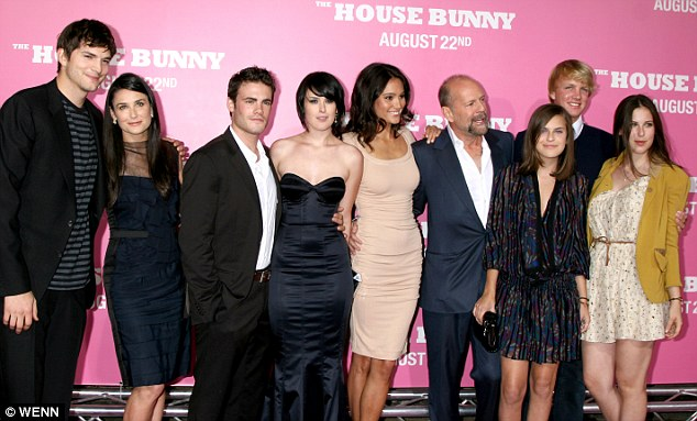 One big happy: Demi and Ashton pose with her three daughters, her ex-husband Bruce Willis and his new wife Emma Heming in 2008