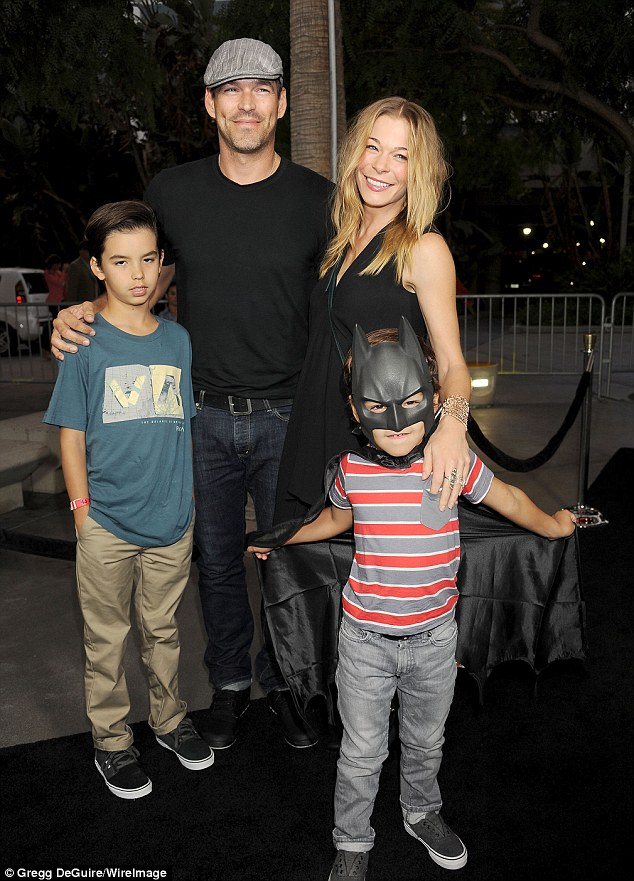 Road to recovery: LeAnn Rimes and husband Eddie Cibrian hit the red carpet with children Mason and Jake at the opening of Batman Live in Los Angeles on Thursday night