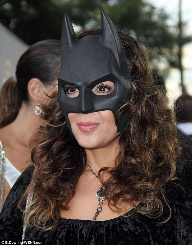 Sexy super-hero: Actress Maria Barrera dons a rubber mask for the as she vamps it up