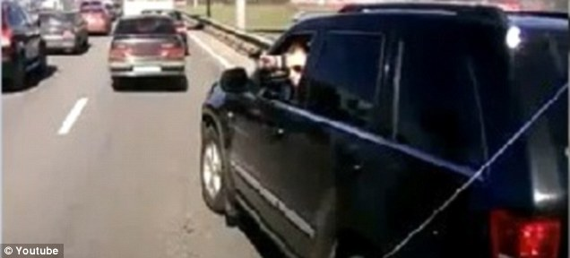 Sinister: A man appears to point a gun out of his window at another motorist