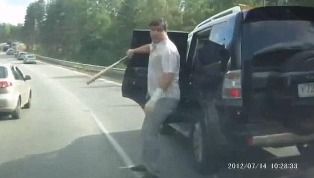 Take bat! A driver vents his fury by grabbing his baseball bat