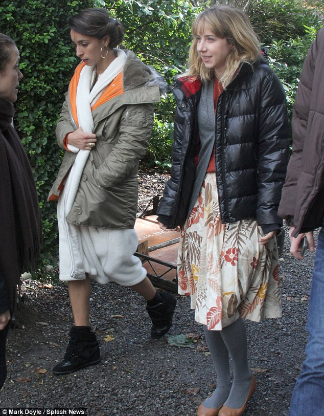 It's a wrap-up: The film's stars, including Zoe Kazan (r), wrap up warm to combat the chilly weather
