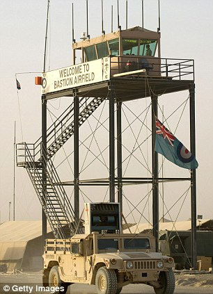 An armoured vehicle passes a watchtower at Camp Bastion Airfield in Helmand Province, Afghanistan where baby Immanuel was born