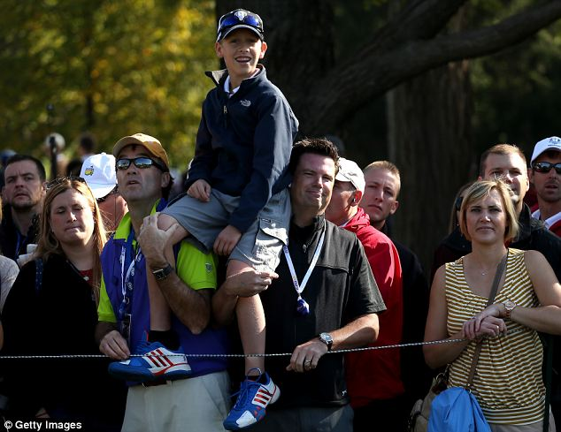Great view: A young fan watches th action