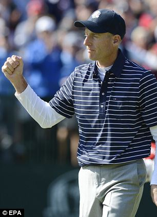 Team USA's Jim Furyk reacts after sinking his putt on the fourteenth hole