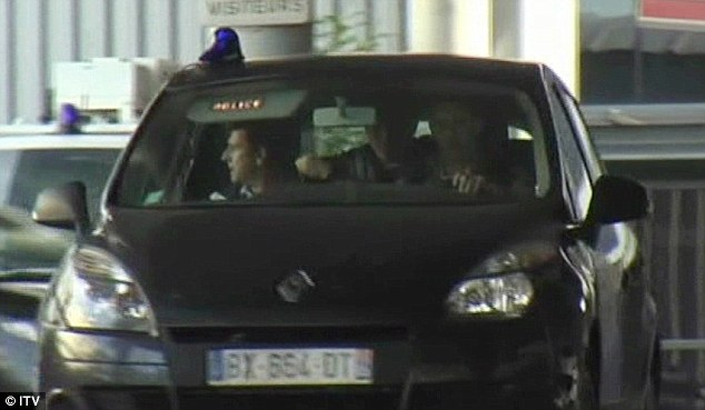 Jeremy Forrest is seen in the back of  french police car after being accused of child abduction