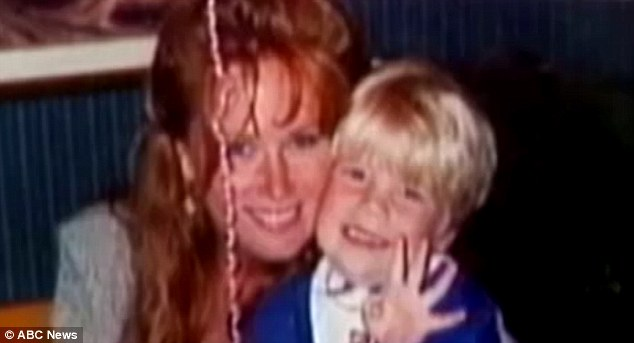 Happier times: Karmen Smith is pictured with Nick in an undated family photo