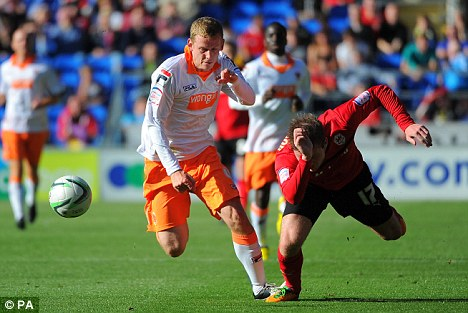 Falling for it: Blackpool's Scott Robinson (left) takes the ball past Aron Gunnarsson