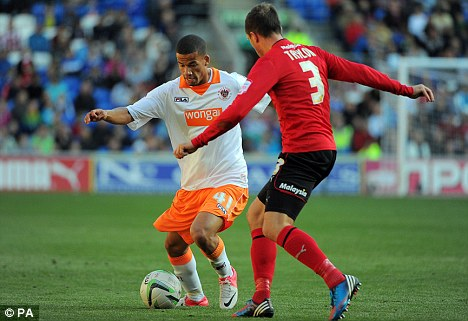 Not this time: Blackpool's Nathan Eccleston tries to get past Andrew Taylor