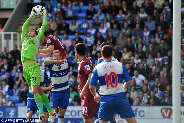 Aerial supremacy: reading keeper Alex McCarthy claims the ball under pressure from Mike Williamsobn