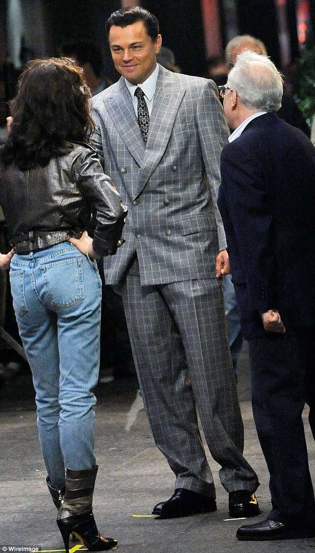 Happy: DiCaprio shares a joke between takes with his co-star Miliot as director Martin Scorsese stands by