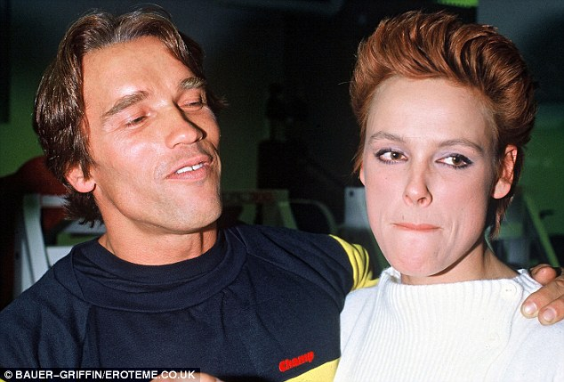 Cuddling up: Arnold appeared very enamoured with Nielsen in these vintage snaps