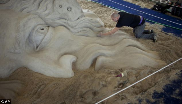 Sand sensation: Bagrat Stepanian puts some last minute touches on a sand sculpture created along with Pavel Mylnikov from Russia, for the 2012 North American Sandsculpting Championship