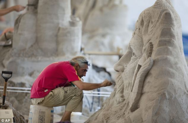 Tonnes to turn: Benjamin Probanza from Mexico works on his sculpture made of sand, imported from North Carolina to Virginia Beach. Organisers imported 450 tonnes of sand specially for the competition