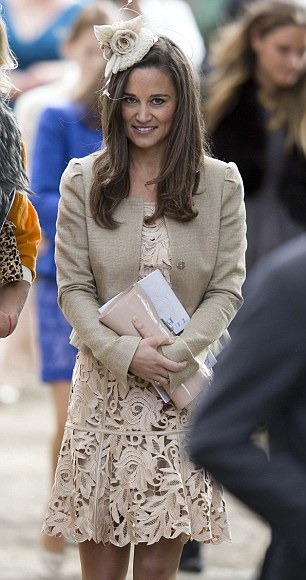 Pippa wore a coffee-coloured dress in broderie anglaise