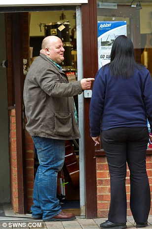 Chatting with the locals: Mr Bayford enjoys a spot of banter with a passer-by