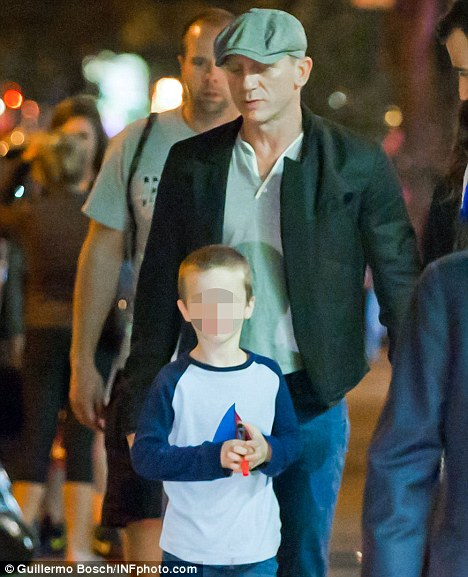 Doting dad: Daniel Craig and his stepson, Henry Chance Aronofsky, seen out after having dinner on Thursday in New York
