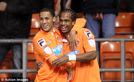 Star: Thomas Ince (left) has shone since joining Blackpool last year