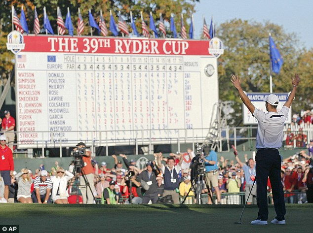 Magic moment: Kaymer sinks the winning put on the 18th before running over to celebrate with his team-mates
