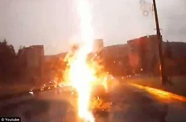 Divine fire: The car is engulfed in flames, likely shocking the driver as the incident is over in the space of a second