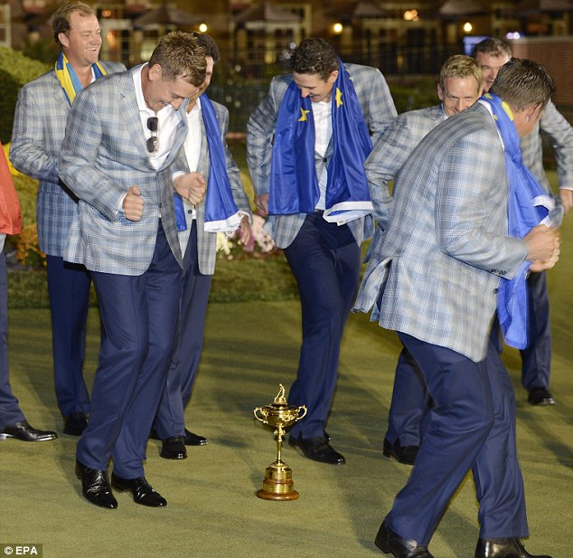 Funky movers: Some of the European players do Ollie's dance round the Ryder Cup