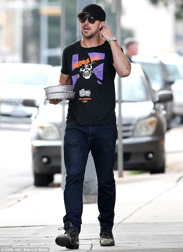 Feeling festive? Ryan Gosling steps out in a Halloween T-shirt a month before the actual ghoulish occasion as he strolls around Austin, Texas