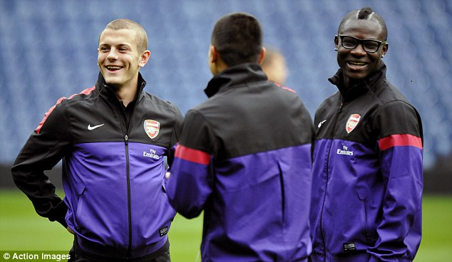 All smiles: Wilshere joined Emmanuel Frimpong, who's had his own problems