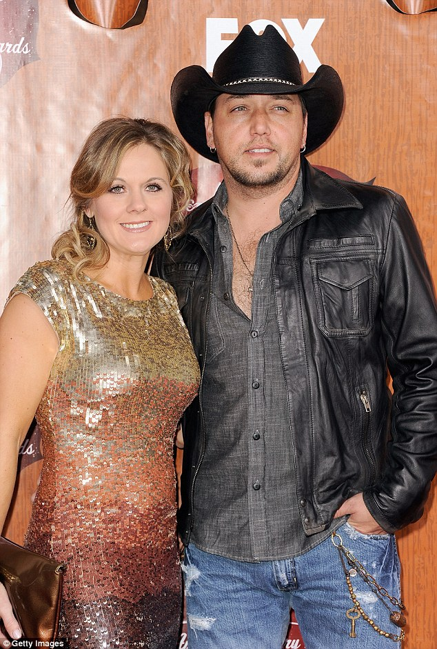 Married man: Jason and his wife, Jessica, pictured at the American Country Awards in December, share two children and have been married since 2001