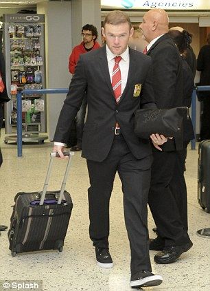 Euro mission: Wayne Rooney (left) and Rio Ferdinand (right) set off from Manchester airport