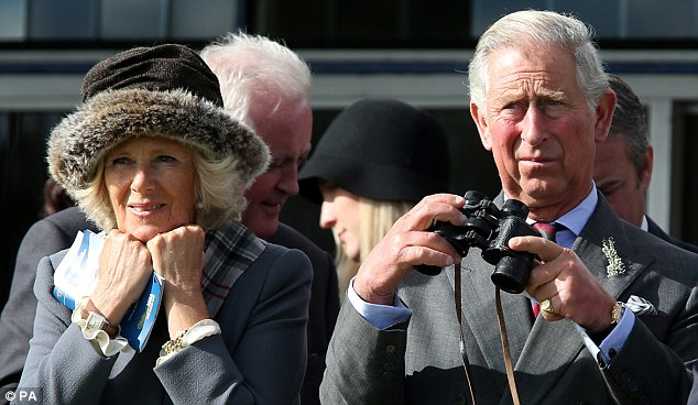 The Prince of Wales and The Duchess of Cornwall watch horse racing at Ayr Racecourse in Ayrshire on September 21.