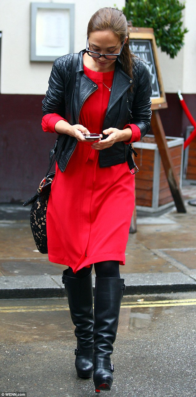 Hot as hell: Myleene Klass stepped out of her solicitor's office in London on Monday looking stylish in a red dress, which she cleverly matched with red-soled Louboutins