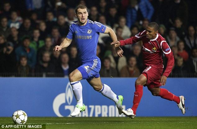 Searching for options: Chelsea's Branislav Ivanovic (left) holds off Nordsjaelland's Patrick Mtiliga